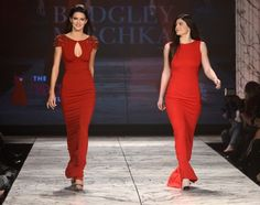 Kendall and Kylie Jenner walk the runway at The Heart Truth 2013 Fashion Show at Hammerstein Ballroom on February 6, 2013 in New York City.  (