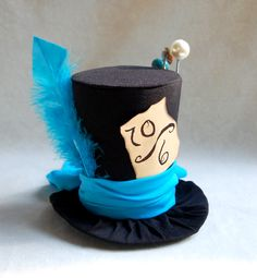 Tiny Top Hat: The Mad Hatter Blue - Lolita Cosplay Costume Party Fascinator Photo Photography Prop Wedding Tophat Small Mini Miniature. $33.00, via Etsy.