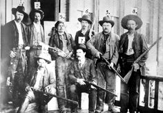 After many attempts, a Deputy U.S. Marshal posse of 17 men finally captured elusive outlaw, Ned Christie. Seven of the posse members are pictured here with Christie's corpse (5) in Fort Smith, Ark. The posse needed a U.S. Army cannon procured from Fort Scott, Kansas and dynamite to force Christie out in the open to kill and capture him on Nov. 3, 1892. *s