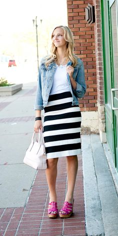 This sexy textured black and white stripe skirt is a key staple for all seasons. The fabric has a little bit of a stretch, but form fitting. Follow washing instructions on tag.
