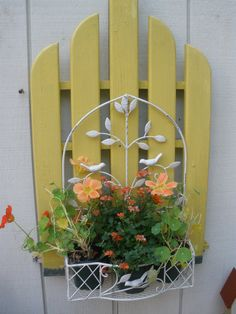 Pinner said:   made this from the back of a rotted Adirondack chair and a basket bought at Joann Fabrics