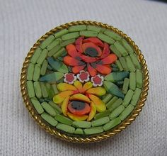 Vintage Italian Micro Mosaic Brooch. I love the green basket-weave around the flowers--Pretty!