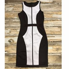 "Black & White Bodycon Dress Color Blocked Dress.  Tag Size: Medium.  95% Cotton 5% Spandex.  Unbranded.  Bust 31""-36"" ( Flat / Stretched).  Length 34 1/2"".  Zipper Back.  Very Good Condition.  Minor Stretch to Backside Seam.  Extra Stitching on Shoulder Seam.  Mannequin is a size small. Sexy Dress! Unbranded Dresses Mini"