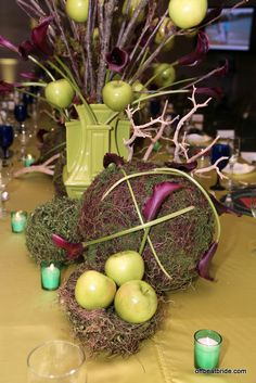 Apples skewered on bare branches + purple calla lilies = tablescape that will haunt your dreams | Offbeat Bride