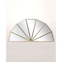 Add a touch of metallics to your walls with the Pin Wheel Mirror, pairing a gold metal frame with glass, made up of triangles arranged in a semi-circular shape. Display with other mirrors or wall art to create an artful statement feature wall in your home.