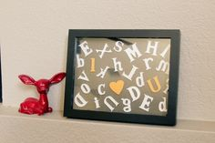 For baby's room (or any room) - need a shadowbox frame, wooden letters, paint and hot glue.