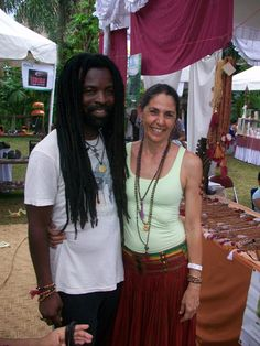 Soma Temple & Rocky Dawuni @ Bali Spirit Festival wearing Mala Spirit Jewelry  About Soma Temple: owner Aum Rudraksha Designs  About Rocky: Ghanaian international music star Rocky Dawuni has leveraged his popularity across the African continent to bring his unique Afro Roots sound to global audiences and champion social causes.