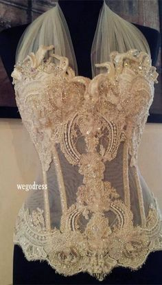 Beautiful sheer beige blouse with embroidery design and pearl-beads embroidered into the blouse.
