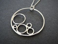 Bubble Necklace/Concentric Circle Necklace/Silver Circle Necklace/Circles Necklace/ Bubbles Necklace Sterling silver circles pendant, geometric bubble pendant, minimalist pendant,circles in a circle pendant, silver circles necklace Diamond Cross Necklaces, Geometric Necklace, Circle Necklace, Drop Necklace, Drop Earrings, Nameplate Necklace, Silver Pendant Necklace, Sterling Silver Pendants, Silver Jewelry Box