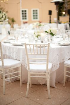 guests were greeted with champagne and a custom-engraved handkerchief favor as they were escort into the lovely citrus garden. Nostalgic white touches were all around: elegant Battenberg lace linens