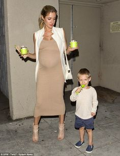 Mommy and me: A very pregnant Kristin Cavallari showed off her growing bump while grabbing...