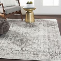 """This lovely collection features a distressed Persian pattern in a beautiful blend of light gray, charcoal, and white. Gorgeous and soft, this rug features a comfortable pile with minimal shedding. Great for high-traffic areas. Machine made in Turkey with 100% polypropylene. Spot or professionally clean only. Rug pad recommended. Pile Height: 0.31"""" Material: 100% Polypropylene Rug Type: Indoor Colors: Light Gray, White, Charcoal Style: Traditional Pattern: Oriental Persian Pattern, White Charcoal, Grey And White Rug, White Rugs, Blue Grey, Living Room Area Rugs, Dining Room Area Rug Ideas, Dining Rooms, Area Rugs For Sale"""
