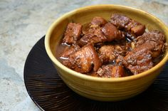 Recipe for Filipino Pork Adobo...pork stew meat simmered in a vinegar-soy sauce mixture and lots of garlic