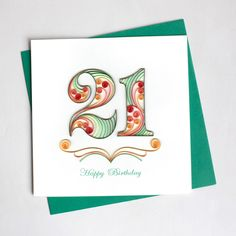 "Outside Copy: Happy Birthday Inside Copy: Blank Inside Size: 6"" x 6"" Description: All of our cards come with a coordinating envelope, and a short history of quilling on the back of the card. Our square cards require extra postage."