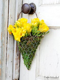 DIY Floral Sconce Bouquet: Fill this handmade piece with her favorite blooms and Mom will be delighted to hang this accessory anywhere. Click through to find more creative ideas for Mother's Day flower bouquets.