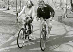 Deborah Raffin and David Janssen ride bikes.