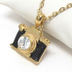"Do you remember what started your love for photography?  This beautiful black and gold mini camera charm necklace represents your love for photography and the story behind the camera.  The PhotoCharm measures approximately 1"" X 1"" and comes on a 19"" snake chain.  *This is a perfect gift for photographers and photography lovers!"