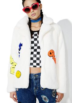 Put 'Em Up Faux Fur Coat yer the perfect storm, babe. Keep warm in this bright white faux fur jacket that has a thick collar and multi-colored patches on the front.
