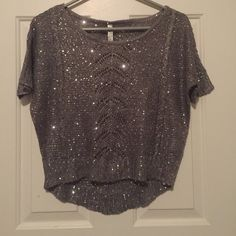 absolutely/sweater Absolutely great sweater with sparkly sequins. Very light lace like material. The front is a little bit shorter then the back. Pictures don't give it justice. No flaws! Extremely beautiful in person. Size small. Only one one time. Absolutely Tops