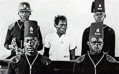 A Kenyan 'Mau Mau' freedom fighter, Waruhiu Itote, stands in the dock in a British colonial court during the 1950's Mau Mau independence rebellion. It involved a Kikuyu-dominated anti-colonial group called Mau Mau and elements of the British Army, auxiliaries and anti-Mau Mau Kikuyu. The movement was unable to capture widespread public support. The conflict set the stage for Kenyan independence in December 1963.