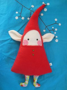 This listing is for one (1) elf doll with bright red outfit. My elf dolls are made of fleece, misc. fabrics, plastic eyes, buttons and jingle bells. This elf is approx. 16 H x 9.5 W stuffed NOT INCLUDING flopped part of hat. Top of hat is UNSTUFFED to maintain good floppiness and plenty of jingle! This elfs fleece is soft and its stuffing is squeezable! It will do well next to your childs pillow or on your couch next to your favorite cushions. These dolls have small parts and are NOT inte...