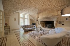 Stunning château living room with vaulted ceilings. Available for holiday rental to sleep 15 people. www.purefrance.com