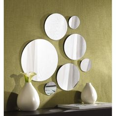 Features: -A clean, non-intrusive design adds a subtle touch to any decor. -These mirrors display a simple, art deco style for a truly eclectic look. -Group mirrors together or hang separately for