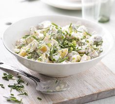 Swap most of the mayo for yogurt and crème frâiche and cut the fat of classic new potato salad by almost two thirds