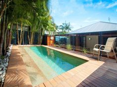 In-ground pool design using timber with decking & outdoor furniture setting - Pool photo 1038211