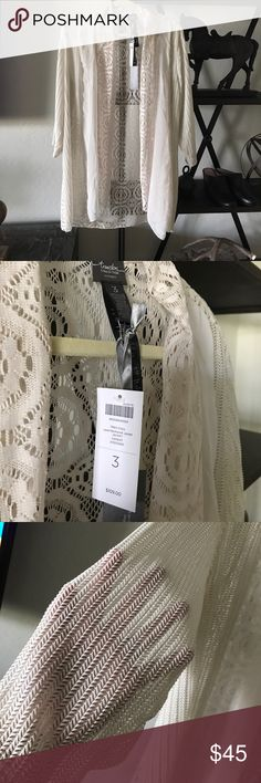 Chicos travelers lace patchwork jacket cardigan This is brand-new with tags I paid $109 it's a lovely light weight sheer wrinkle free packable material goes great with anything it has an open drape  front with three different sheer materials mixed sz 3 Chico's Sweaters Cardigans