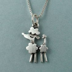 LOVE THIS! Just add ankle bracelets and it's Phaedra! Poodle necklace. $28.00, via Etsy.