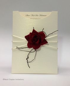 JOELENE  A beautifully textured invitation using a White Gold C6 Invitation Pocket stylishly highlighted with a red velvet rose and vine twig tied with Ivory China Cord Ribbon. Completed Invitation with Envelope Box:$7.95 https://www.facebook.com/NextChapterWeddingInvitations