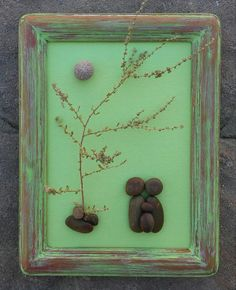 FREE SHIPPING  Beautiful one of a kind piece ! Little pebble family of Three. The frame is painted in acrylics and lightly distressed. It is open and measures approximately 5x7. It can be displayed on a table.  Awesome gift for newly expecting parents, or parents with a small child.  Thank you so much for looking. Please message with any questions....P.S. I love special requests