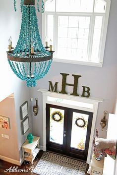 Not a fan of the chandelier, but I like the shelf molding over the entry door. Might work well in our 2 story foyer. decor 2 story Our Statement Making Foyer Tour - Addison's Wonderland Stairway Decorating, Foyer Decorating, Decorating Ideas, Decorating Bathrooms, Decor Ideas, Vestibule, Entryway Decor, Wall Decor, Family Room