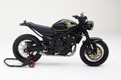 Unlikely Candidate: MAD Industries and Lossa Engineering have lightly scrambled the Honda CB500F. Love that classic black-and-gold paint.