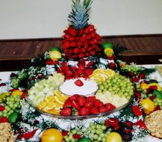 Fruit display with a large fruit tray & dip, and a strawberry tree in the back center~