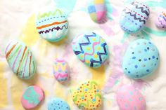 """Painted rock Easter eggs are fun and easy to make. With a little paint and a few dots and squiggles, you can transform an ordinary rock into an """"Easter Egg"""" that can almost pass for the real thing. Stone Crafts, Rock Crafts, Craft Stick Crafts, Crafts To Do, Crafts For Kids, Baby Crafts, Craft Ideas, Rock Painting Supplies, Rock Painting Ideas Easy"""