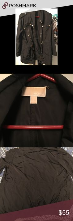 Michael kors rain jacket Black and gold, a little past hip length, with drawstring in the middle to tighten KORS Michael Kors Jackets & Coats Trench Coats