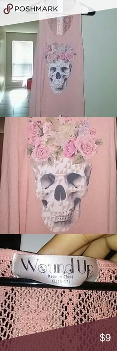 Peach skull tank top Really cute. Split in back. Comfy material. Worn once. Glitter is still on flower crown of skull. Wound Up Tops Tank Tops
