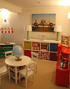 Colorful play room with IKEA Expedit shelving unit - LOVE the airplane pic! Ephraim neeeeds one ;)