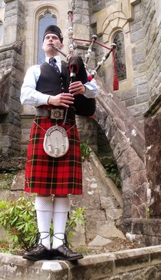 Piper at St. Conan's Kirk, Scotland