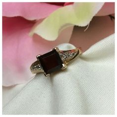 Garnet n Diamonds set in 10k Yellow Gold Garnet n Diamonds set in 10k Yellow Gold, approximate size 6.5, plenty of gold in band for jeweler to resize if necessary Jewelry Rings