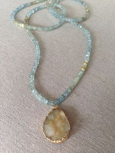 Items similar to Moss Aquamarine and Brushed Gold Beaded Necklace with Druzy Pendant on Etsy - Items similar to Moss Aquamarine and Brushed Gold Beaded Necklace with Druzy Pendant on Etsy Moss Aquamarine and Brushed Gold Beaded by GoldenstrandJewelry Boho Jewelry, Jewelry Crafts, Jewelery, Beaded Jewelry, Fine Jewelry, Jewelry Necklaces, Jewelry Design, Fashion Jewelry, Jewelry Making