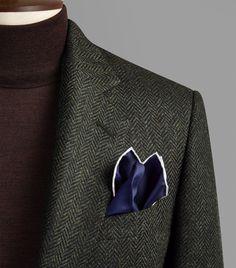Olive green and dark grey herringbone single breast sports coat. 100% wool. Made in England.