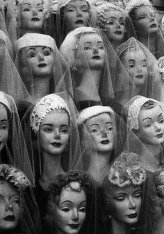 Great photo of mannequin heads showing bridal veils.