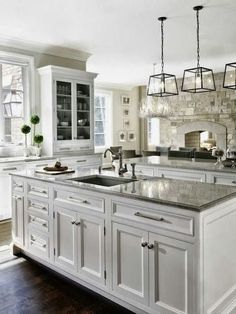 Maybe our Kitchen could look SORT of like this? Need to paint the cabinets, put glass doors on the uppers, remove the wall =), and put the sink in an island. That's not a lot, right?