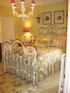 Great yellow bedroom~love the iron bed!