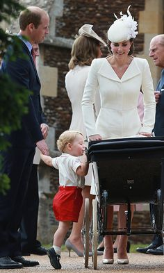 The Cambridges made their first outing as a family of four at Princess Charlotte's christening in July 2015, and Prince George couldn't resist taking a peek into his sister's pram as they mingled outside the church.<br><br>Photo: © Getty Images
