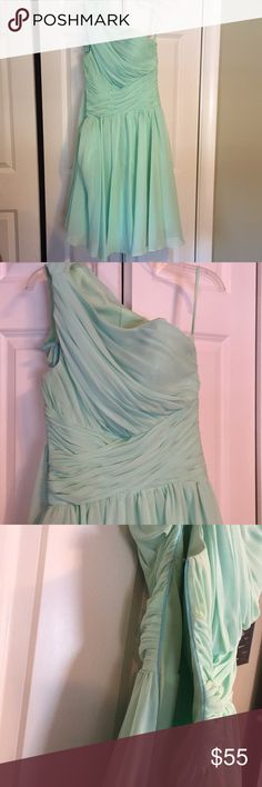 One-shoulder bridesmaid dress Mint green bridesmaid dress. One-shoulder with a side zipper. Double layer skirt. Padded cups built into the bust. Slight snag in the top layer of the skirt (as shown). Worn once. 100% polyester. Size 2. Dresses One Shoulder