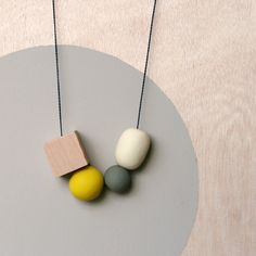 """Minimalist necklace by Rachel Wightman, from her """"not Tuesday"""" series. Wood, cord."""
